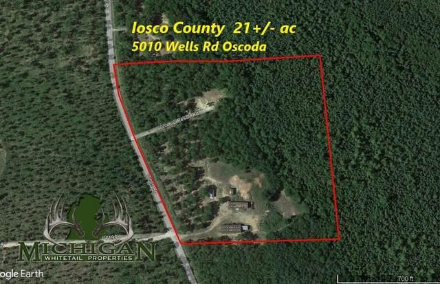 5010 Wells Rd, Oscoda, MI 48750 (MLS #21104698) :: CENTURY 21 C. Howard