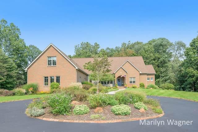 10600 Baker Avenue SE, Alto, MI 49302 (MLS #21104852) :: Sold by Stevo Team | @Home Realty