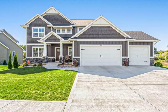 14652 Arcadia Woods Drive, Spring Lake, MI 49456 (MLS #21106445) :: CENTURY 21 C. Howard