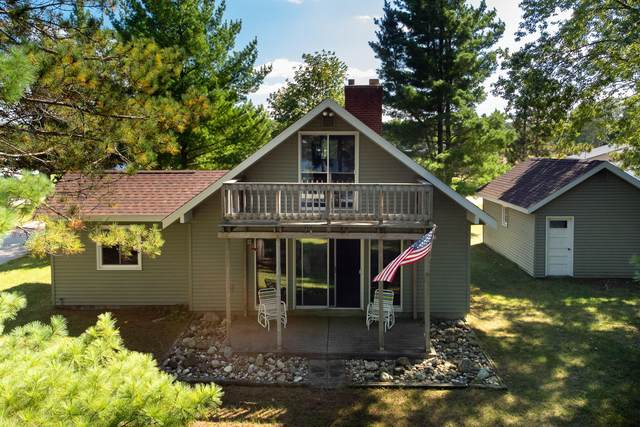 5559 N Sauble Lake Drive, Irons, MI 49644 (MLS #21106941) :: Sold by Stevo Team | @Home Realty