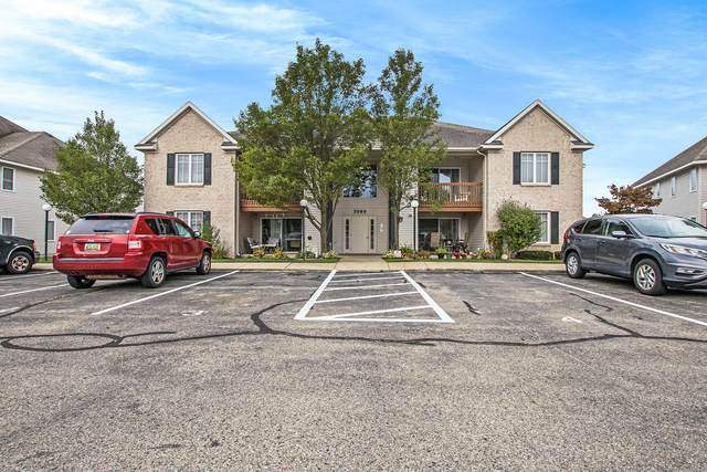 3089 E Crystal Waters Drive #8, Holland, MI 49424 (MLS #21107723) :: JH Realty Partners