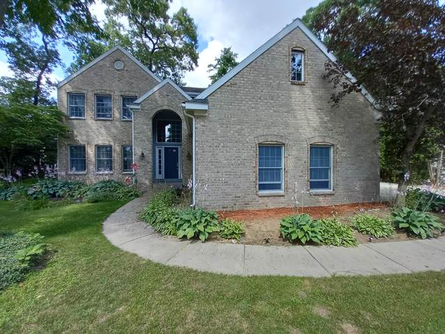 15441 Oak Point Drive, Spring Lake, MI 49456 (MLS #21109937) :: Sold by Stevo Team | @Home Realty