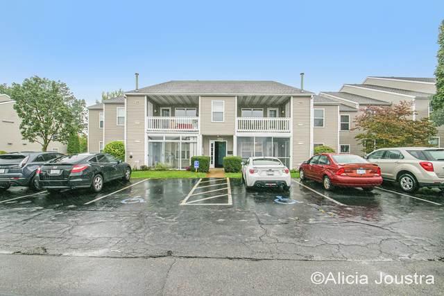 3027 Poplar Creek Drive SE #202, Kentwood, MI 49512 (MLS #21110488) :: The Hatfield Group