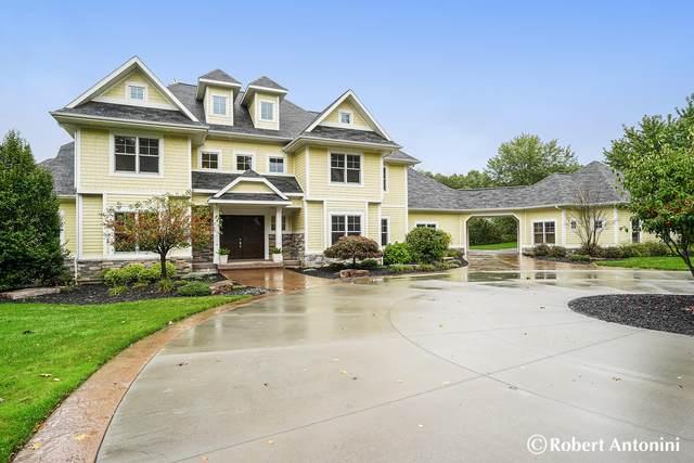 7339 Fairhaven Court NE, Ada, MI 49301 (MLS #21111079) :: Sold by Stevo Team | @Home Realty