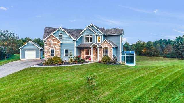 7826 Prairie Crossing Lane, Kalamazoo, MI 49004 (MLS #21111116) :: Sold by Stevo Team | @Home Realty