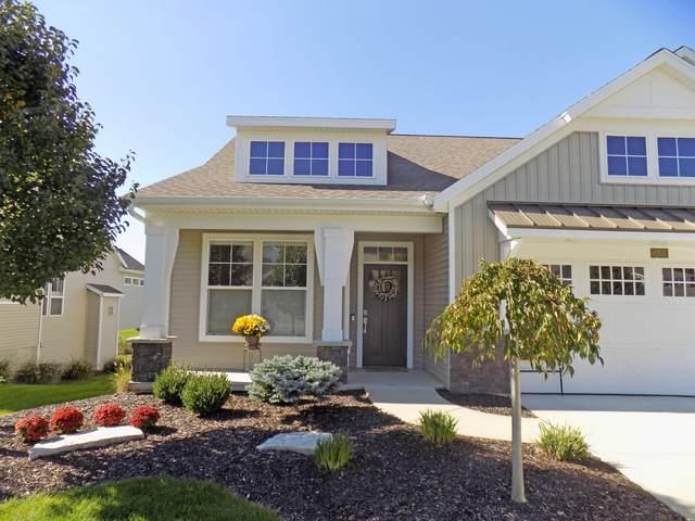 6205 Harmon Green Avenue, Grandville, MI 49418 (MLS #21111324) :: JH Realty Partners