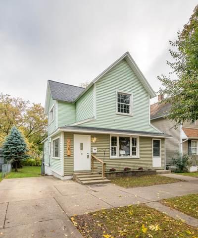 1128 Mcreynolds Avenue NW, Grand Rapids, MI 49504 (MLS #21112660) :: The Hatfield Group