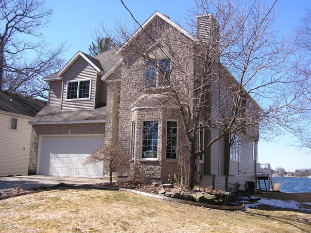 7562 Hessler Drive NE, Rockford, MI 49341 (MLS #18011002) :: Deb Stevenson Group - Greenridge Realty