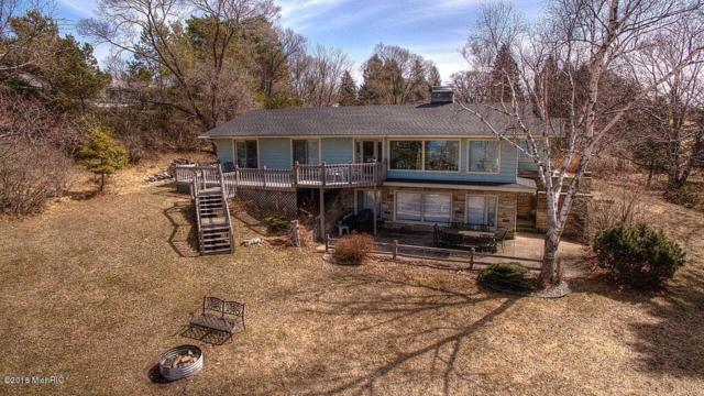 1860 Surfside Drive, Manistee, MI 49660 (MLS #18012050) :: Deb Stevenson Group - Greenridge Realty