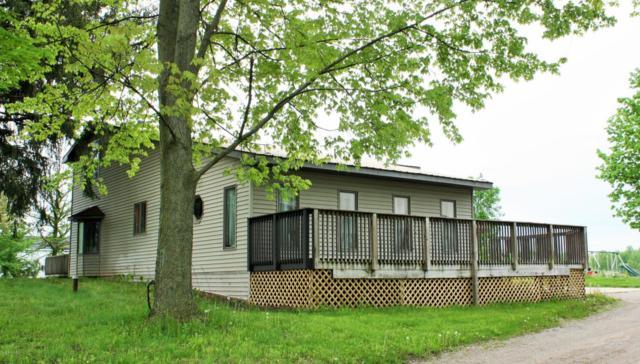 7783 Peddler Lake, Clarksville, MI 48815 (MLS #18022041) :: Deb Stevenson Group - Greenridge Realty