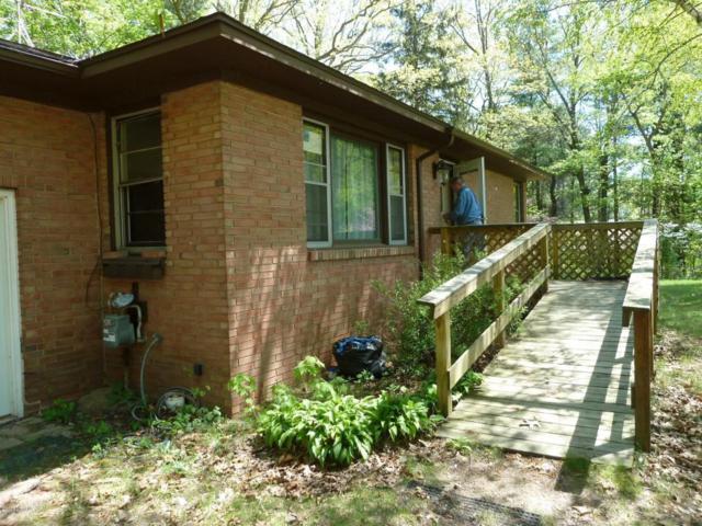 1305 Buth Drive NE, Comstock Park, MI 49321 (MLS #18031066) :: Matt Mulder Home Selling Team