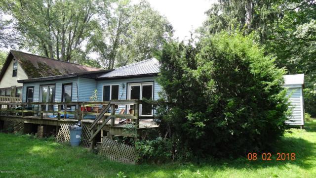 4716 Abrigador Trail NE, Comstock Park, MI 49321 (MLS #18037855) :: Matt Mulder Home Selling Team