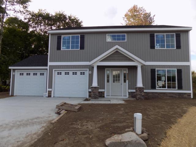 11665 Ridge Water NE, Sparta, MI 49345 (MLS #18047787) :: Deb Stevenson Group - Greenridge Realty
