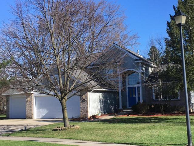 5504 E Heathwood Drive SE, Kentwood, MI 49512 (MLS #19015545) :: Deb Stevenson Group - Greenridge Realty