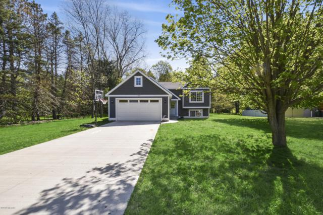 13836 Windemere Drive NW, Grand Rapids, MI 49534 (MLS #19020787) :: Matt Mulder Home Selling Team