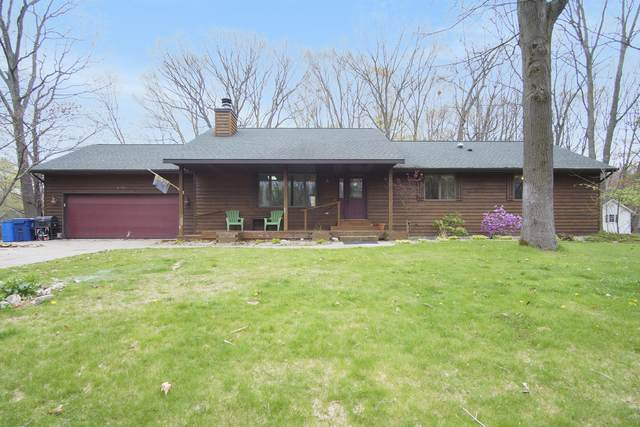 6724 Burton Woods Drive, Whitehall, MI 49461 (MLS #21014329) :: Your Kzoo Agents