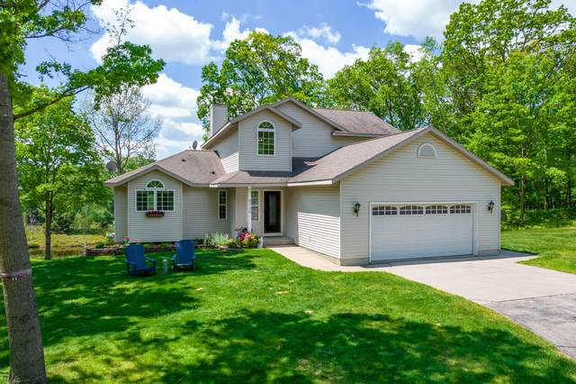 9135 N Trap Drive, Canadian Lakes, MI 49346 (MLS #21020755) :: JH Realty Partners