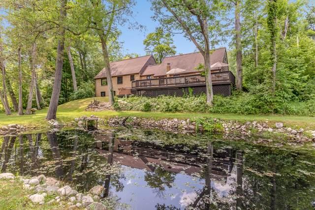 700 Norway Street, Baldwin, MI 49304 (MLS #21022555) :: Sold by Stevo Team | @Home Realty