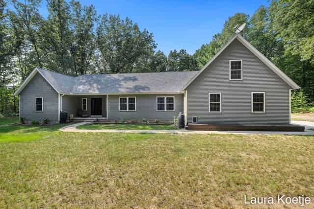 16477 Whispering Oaks NW, Kent City, MI 49330 (MLS #21098458) :: BlueWest Properties