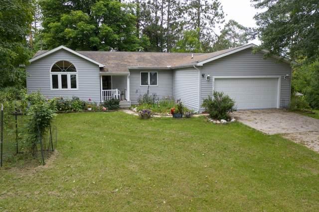 211 N Cedar Street, Evart, MI 49631 (MLS #21106049) :: The Hatfield Group