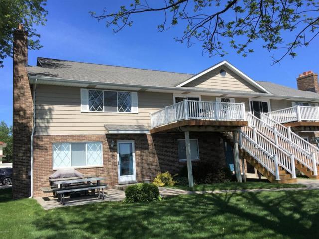 4715-#203 Main Street, Onekama, MI 49675 (MLS #16030536) :: Deb Stevenson Group - Greenridge Realty