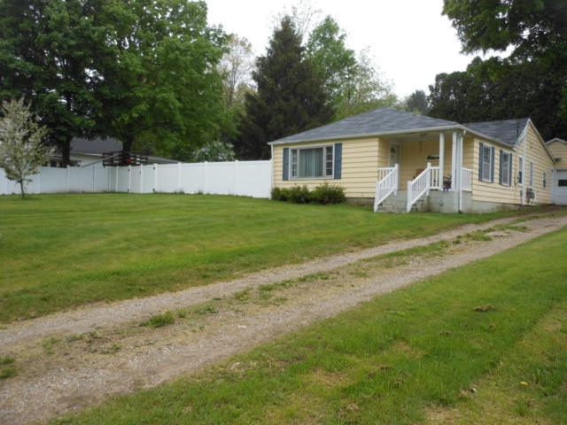 5549 Whitneyville Avenue SE, Alto, MI 49302 (MLS #18020125) :: Deb Stevenson Group - Greenridge Realty