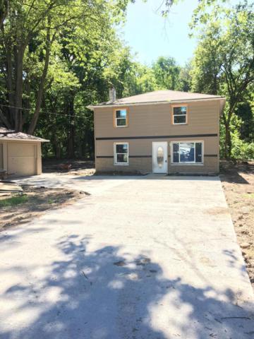 7000 N Aurelius Road, Lansing, MI 48911 (MLS #18024945) :: Carlson Realtors & Development