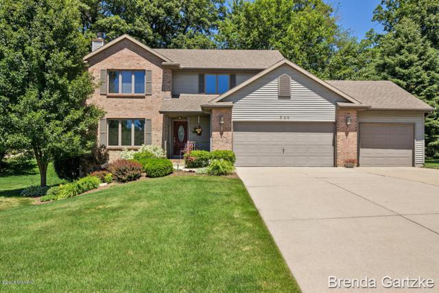 711 Pendleton Drive NE, Comstock Park, MI 49321 (MLS #18031913) :: Matt Mulder Home Selling Team