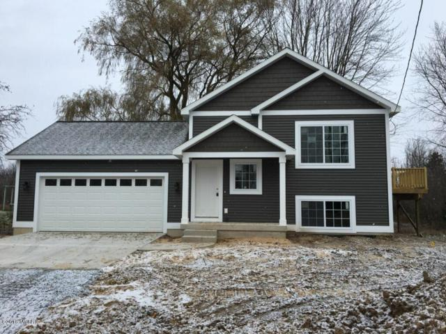 161 E Randall Street, Coopersville, MI 49404 (MLS #18048126) :: Deb Stevenson Group - Greenridge Realty