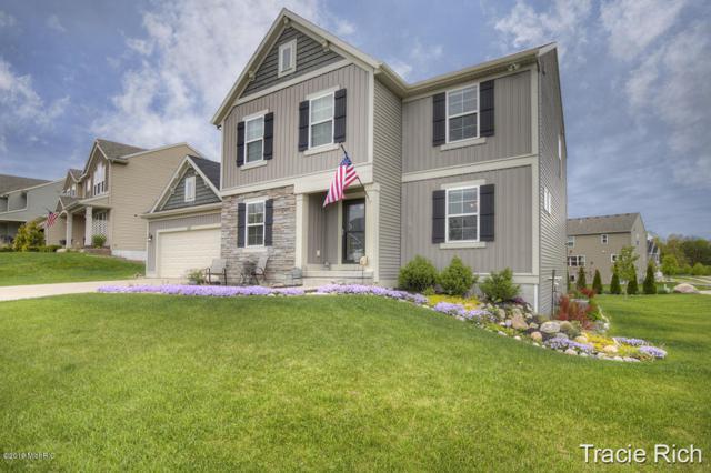 587 Park Place Drive NE, Rockford, MI 49341 (MLS #19018121) :: Matt Mulder Home Selling Team