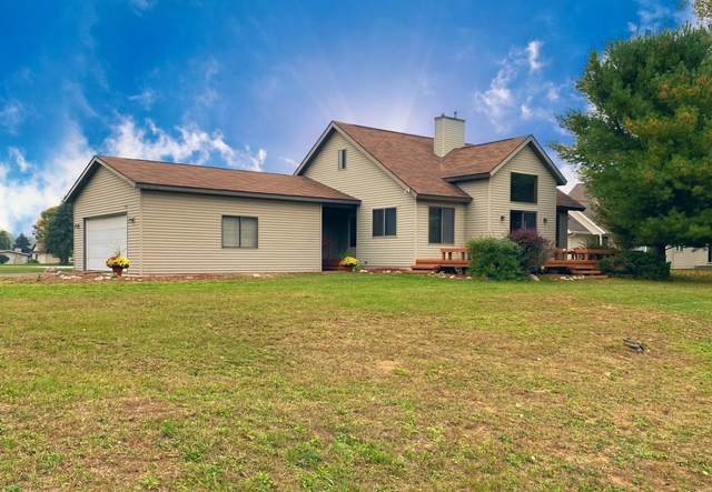 7126 Holiday Drive, Canadian Lakes, MI 49346 (MLS #21109674) :: Sold by Stevo Team | @Home Realty