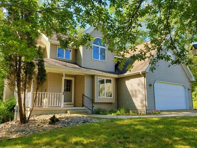 718 E Pine Hill Avenue, White Cloud, MI 49349 (MLS #21014338) :: Sold by Stevo Team | @Home Realty