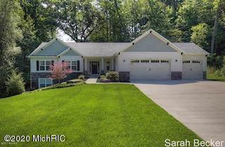 4430 Oak River Drive NE, Grand Rapids, MI 49525 (MLS #20001339) :: JH Realty Partners