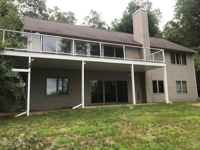 9207 Woodland Drive, Onekama, MI 49675 (MLS #20030831) :: Ron Ekema Team