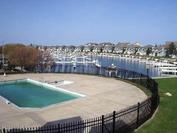 104 Marina Drive, Manistee, MI 49660 (MLS #20047627) :: Deb Stevenson Group - Greenridge Realty