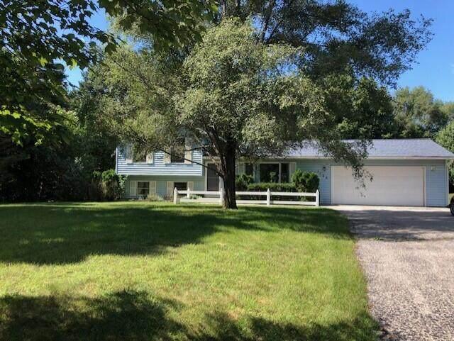 1125 Vega Drive, Traverse City, MI 49696 (MLS #21109837) :: Sold by Stevo Team | @Home Realty