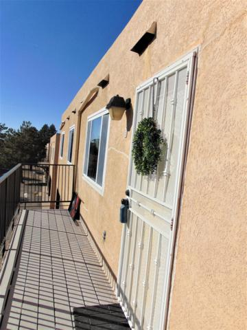 12007 Stilwell Apt A Drive NE, Albuquerque, NM 87112 (MLS #945116) :: Campbell & Campbell Real Estate Services