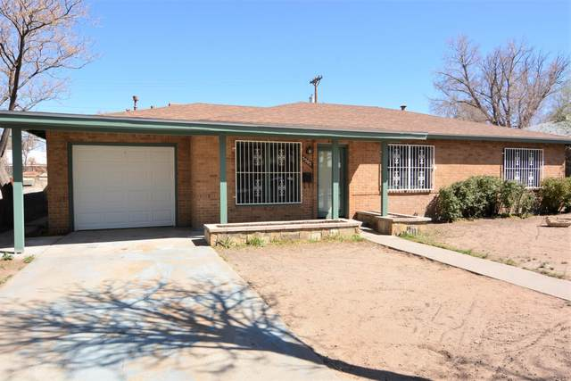 5707 Bellamah Avenue NE, Albuquerque, NM 87110 (MLS #989643) :: The Buchman Group
