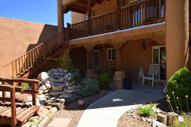 4 Gilcrease Road, Los Lunas, NM 87031 (MLS #899562) :: The Stratmoen & Mesch Team