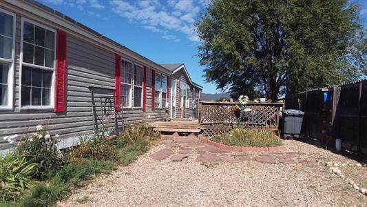 818 Chugar Drive, Las Vegas, NM 87701 (MLS #957325) :: Campbell & Campbell Real Estate Services