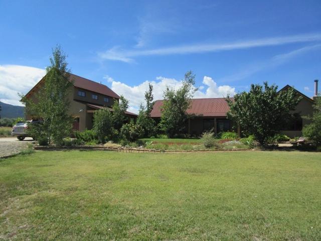 825 Camino Anglada, Taos, NM 87571 (MLS #102759) :: The Chisum Realty Group