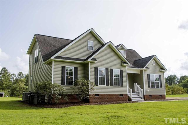 260 Little River Drive, Zebulon, NC 27597 (#2211138) :: The Jim Allen Group