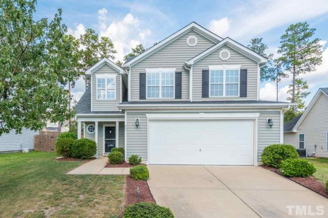 209 Braxcarr Street, Holly Springs, NC 27540 (#2214124) :: The Abshure Realty Group