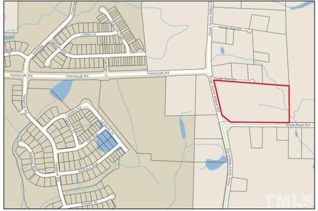 1209 Piney Grove Wilbon Road, Holly Springs, NC 27540 (#2395420) :: The Helbert Team