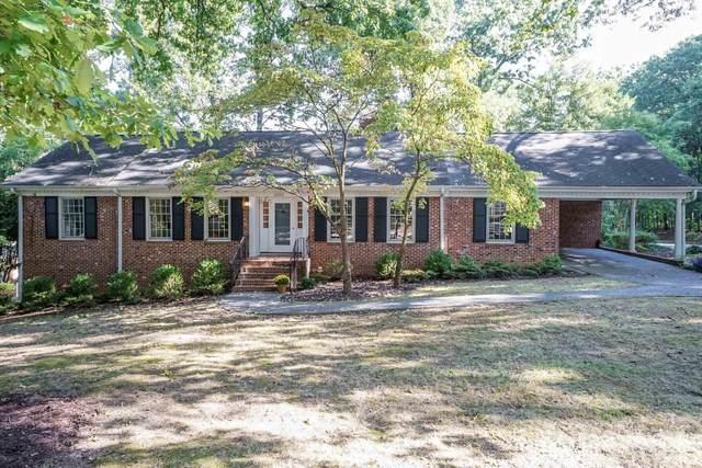 4300 Driftwood Drive, Raleigh, NC 27606 (#2409360) :: The Helbert Team