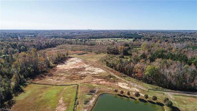 5052 Harvest Road, Mcleansville, NC 27301 (MLS #1026475) :: Ward & Ward Properties, LLC