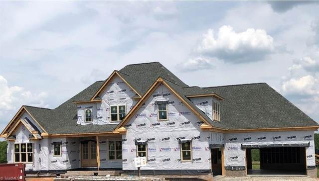 5700 Grey Wind Court, Oak Ridge, NC 27310 (MLS #1027008) :: Ward & Ward Properties, LLC