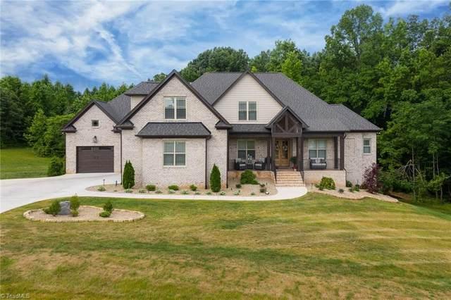 8605 Lathans Trail, Oak Ridge, NC 27310 (MLS #1028313) :: Berkshire Hathaway HomeServices Carolinas Realty