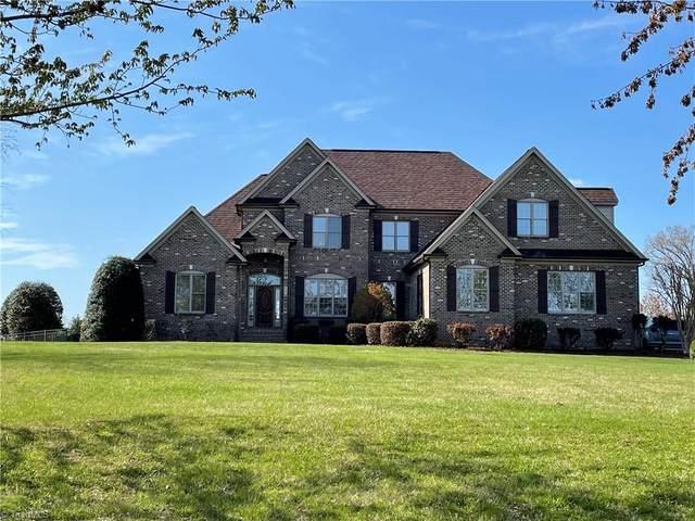5701 Wolf Ridge Court, Oak Ridge, NC 27310 (MLS #1030318) :: Ward & Ward Properties, LLC