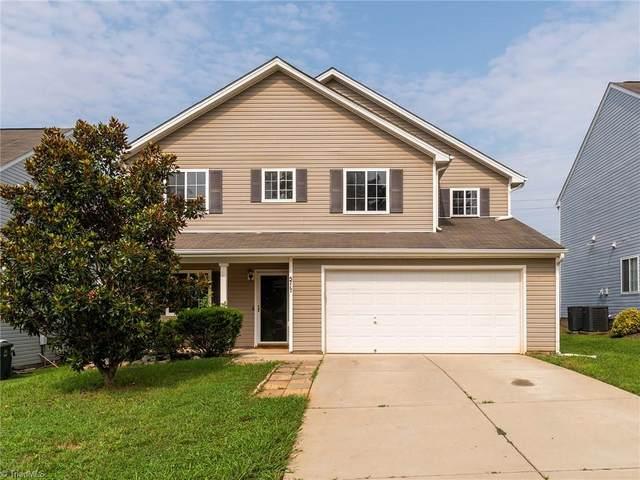 5717 Waterpoint Drive, Browns Summit, NC 27214 (MLS #1034734) :: Ward & Ward Properties, LLC